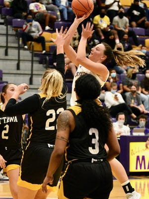 Kansas Wesleyan Amanda Hill (34) puts up a shot over Ottawa's Jill Thlamn (22) during Friday's game at Mabee Arena.