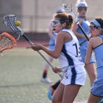 Eastridge's Sofia Agurto-Munding, center, tries to spin away from pressure from Gananda's Jordan Cunningham, right, and Melissa Camp, left, on April 18, 2016.