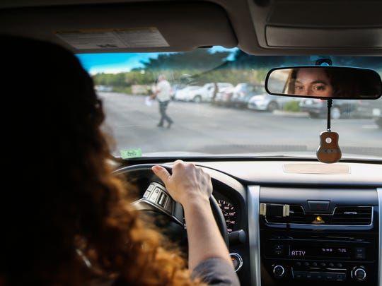 """Aty Gonzalez, 38, pulls into the parking lot of the U.S. Citizenship and Immigration Services office in Fort Myers on Thursday, July 20, 2017. Gonzalez said she was """"very, very nervous."""""""