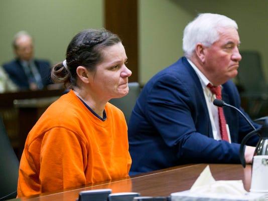 AP WOMAN KILLED BABY TAKEN A FILE USA ND