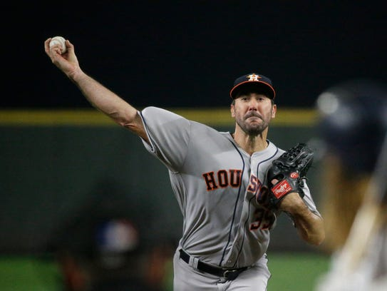 Houston Astros starting pitcher Justin Verlander throws