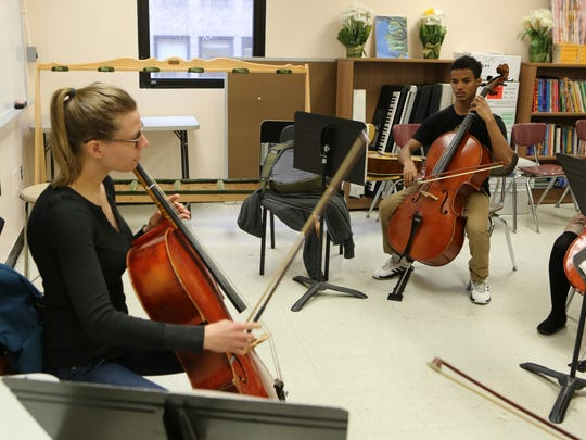 James Sarante, a student at the Manhattan Academy for Arts and Language, plays the cello in the music class led by Amanda Gookin, at the school April, 7, 2016. The cello was donated, through an instrument donation program by WQXR, by Scarsdale resident Alan Weiler.