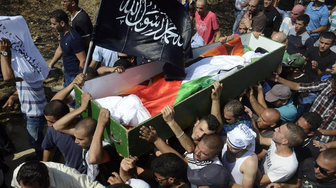 Palestinians carry the body of Mohammed Abu Khdeir, 16,  in Jerusalem on July 4.
