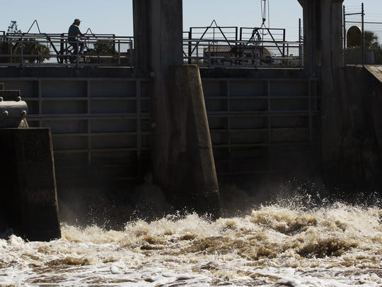Water released from Lake Okeechobee rushes out of the