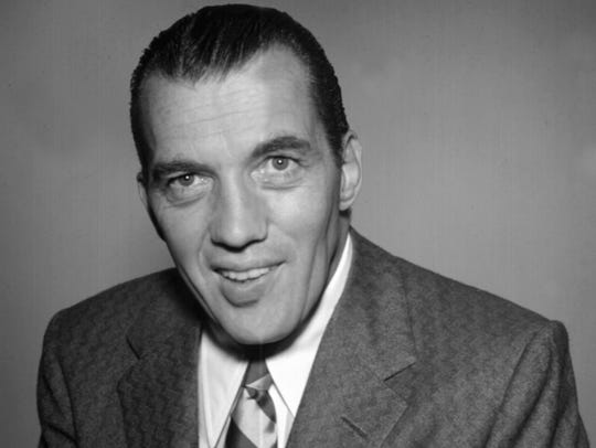 Television variety show host Ed Sullivan poses for