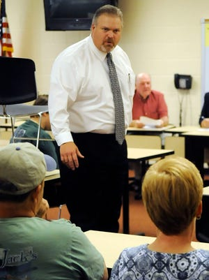 David Gaul greets attendees of a board meeting at Amanda-Clearcreek May 4, 2016, in Amanda. Gaul Was recently placed on paid administrative leave by the district's board of education.