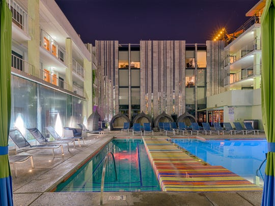 A nighttime view of the oasis pool at the Clarendon