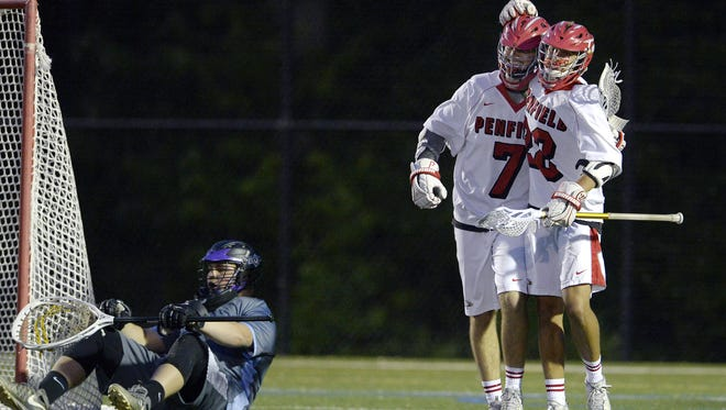 Penfield's Michael Mitchell (7) and Jacob Emmick celebrate the Patriots' 13th goal next to Greece goalie Donald Yandow during a Class A sectional semifinal at Webster Thomas High School, Friday, May 25, 2018. No. 2 seed Penfield advanced to the Class A final with a 13-5 win over No. 3 seed Greece Storm.
