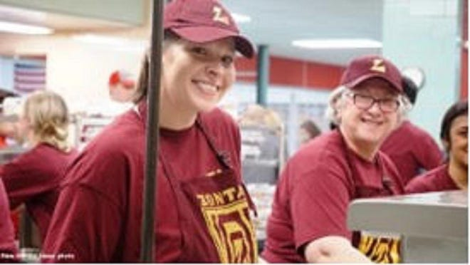 Zonta members Amber Brainard  and Jane Ryan smile while serving past turkey dinners at Lincoln Community High School.