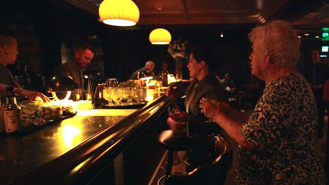Guests of The Desert Sun attend a food and drink tasting event at Mr. Lyons Steakhouse in Palm Springs on May 20. Attendees sample a signature gin and tonic drink, The Spaniard.