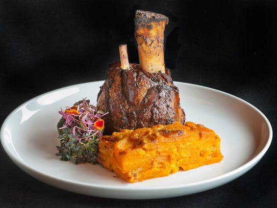 Napa River Grill's Kentucky-raised braised Yorkshire-Duroc pork shank. It's served in a reduction of pork juices and home-made (Jonah Gold Apple) jam and Kentucky sorghum. The dish is served with Swiss chard, marigold petals and micro-amaranth and sweet potato casserole.  Oct. 9, 2017