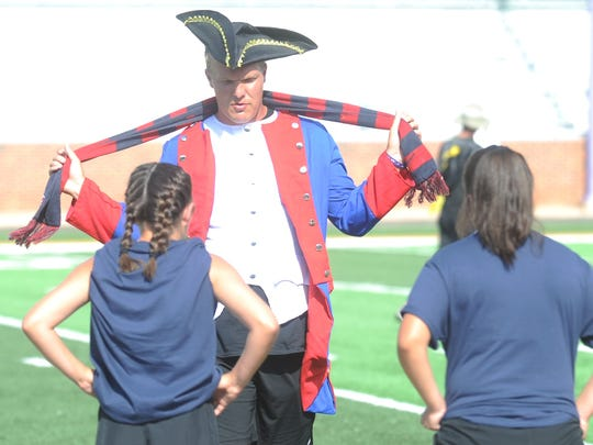 Team USA coach Stephen Salas, dressed as an American colonist soldier from the Revolutionary War, talks to his players during warmups before World Cup Night at Hardin-Simmons' soccer camp Friday, July 7, 2017 at Shelton Stadium. Salas is an assistant women's soccer coach at Abilene Christian University. Players at the HSU camp were divided into teams representing soccer-playing countries from the around the world on the camp's World Cup Night.