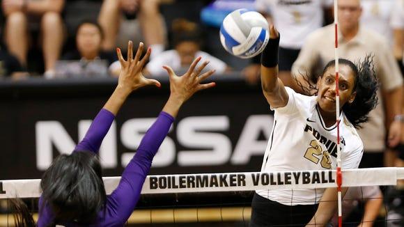 Danielle Cuttino of Purdue spikes the ball past Alana