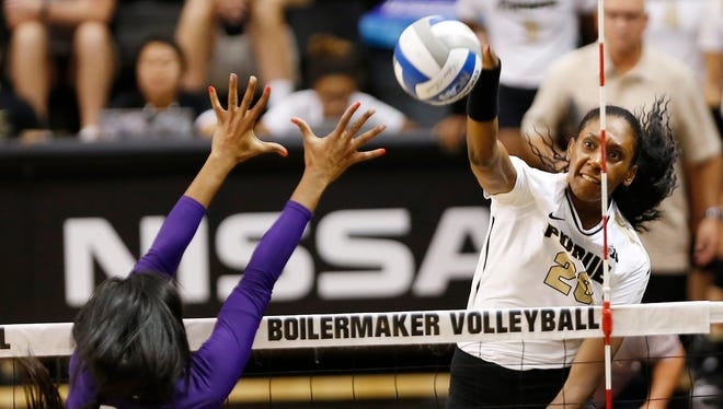 Danielle Cuttino of Purdue spikes the ball past Alana Walker of Northwestern in the first set Wednesday, September 20, 2017, at Holloway Gymnasium on the campus of Purdue University. Purdue swept Northwestern 25-18, 25-20, 25-18.