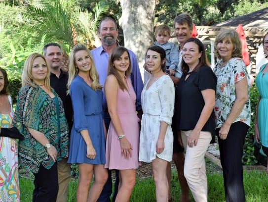 Family members celebrate graduation at the Women's