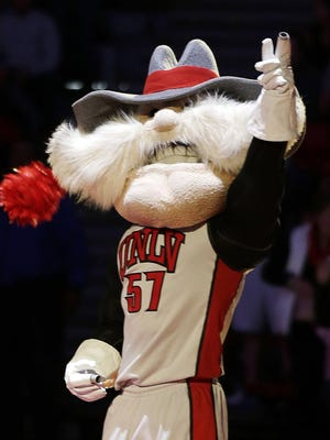 UNLV mascot Hey Reb warms up the crowd before a 2014 NCAA college basketball game in Las Vegas.