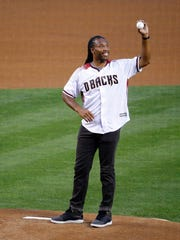 Larry Fitzgerald throws out the first pitch as the