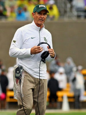 Baylor coach Art Briles stands on the sidelines during his team's game against Iowa State in 2015.