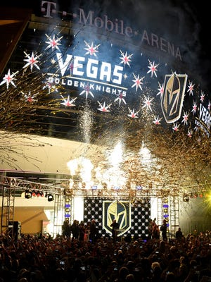 Pyrotechnics and streamers are fired into the air as the Vegas Golden Knights is announced as the name for the Las Vegas NHL franchise at T-Mobile Arena on Nov. 22, 2016 in Las Vegas.