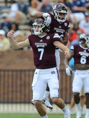 Mississippi State's Nick Fitzgerald (7) is congratulated by Mississippi State's Keith Mixon (23) after scoring a touchdown against Charleston Southern.