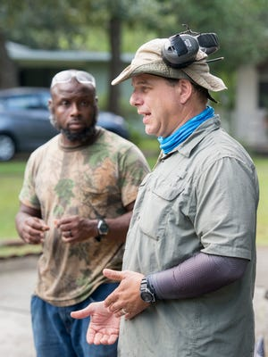Zevin Mitchell, left, listens as Eric Majors talks on Monday, Sept. 25, 2017, about his landscaping business, which gives felons a job and a second chance after being released from prison.