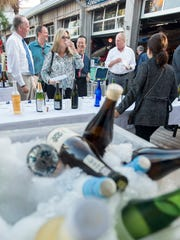 People sample various sake during the Premium Sake