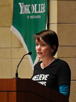 Karen Galbraith, with Pennsylvania Coalition Against Rape, speaks during Take Back the Night in Waldner Performing Arts Center at York College of Pennsylvania in Spring Garden Township, Wednesday, April 11, 2018. The event is one of many activities being held during York College's Week of Action, April 9-13, in recognition of Sexual Assault Awareness Month. Dawn J. Sagert photo