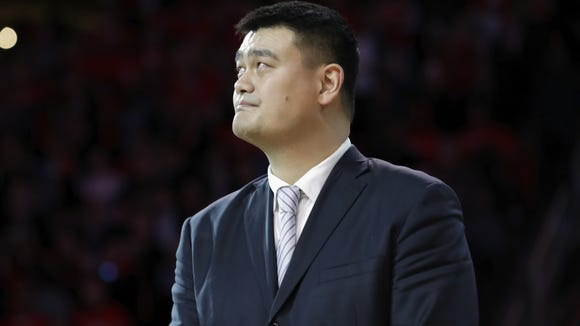 Yao Ming watches as his Houston Rockets jersey #11