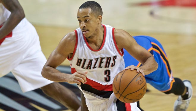Portland Trail Blazers guard C.J. McCollum dribbles to the basket against the Oklahoma City Thunder during the second half of an NBA basketball game in Portland, Ore., Wednesday, April 6, 2016.