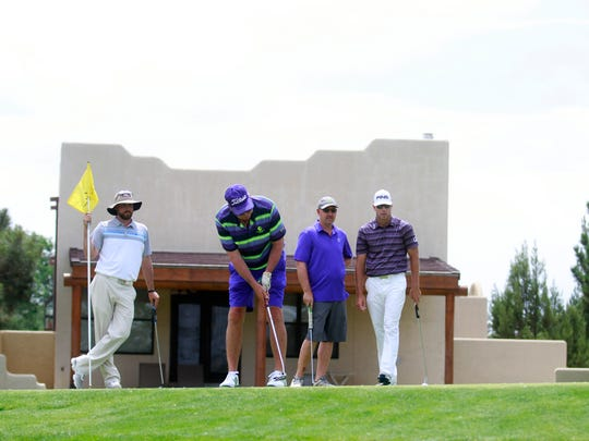 From left, Andy Connell, Gary Sterton, Ken Stevens and DJ Brigman participate in the first day of the San Juan Open on Thursday at the San Juan Country Club in Farmington.