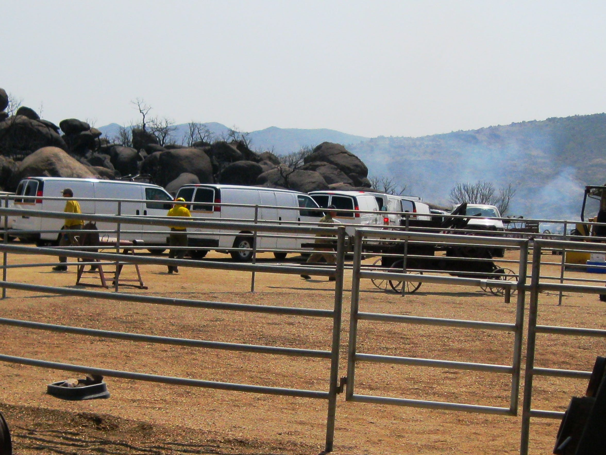 The last of the 10 coroner vans leave the Helm's ranch