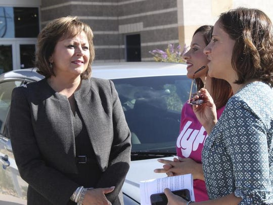 New Mexico Gov. Susana Martinez, left, talks with Lyft