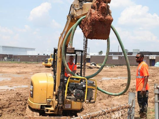 Construction continues at Wossman High School?s football field on Tuesday.