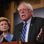 Senate Budget ranking member Bernie Sanders, I-Vt., speaks about ending sequestration alongside Sen. Debbie Stabenow, D-Mich., during a news conference on Capitol Hill on March 11, 2015.