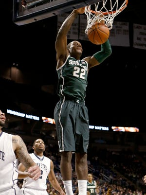 Michigan State's Branden Dawson (22) throws down an easy two in the Spartans' victory.