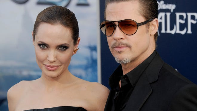 """HOLLYWOOD, CA - MAY 28:  Actors Angelina Jolie and Brad Pitt arrive at the World Premiere Of Disney's """"Maleficent"""" at the El Capitan Theatre on May 28, 2014 in Hollywood, California.  (Photo by Gregg DeGuire/WireImage) ORG XMIT: 494555669 ORIG FILE ID: 494225327"""