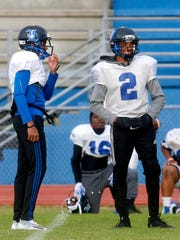 La Vergne's wide receiver Josh Lewis, left and quarterback Keianthony Conner, right, on the sidelines together during practice on Wednesday, Nov. 1, 2017.