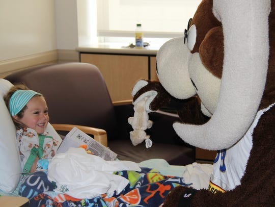 Bruno, the Reno Bighorns mascot, visits children at