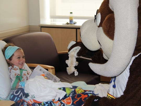 Bruno, the Reno Bighorns mascot, visits children at area hospitals.