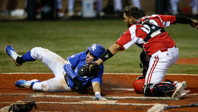 Louisville Cardinals catcher Colby Fitch tags out Kentucky Wildcats outfielder Zach Reks during the game at Cliff Hagan Stadium in Lexington, Kentucky on Tuesday, April 18, 2017. Michael Reaves/Special to The Courier Journal