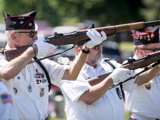 The Delaware County Honor Guard performs a rifle salute at the 146th Memorial Day ceremony in May 2018 at Beech Grove Cemetery.