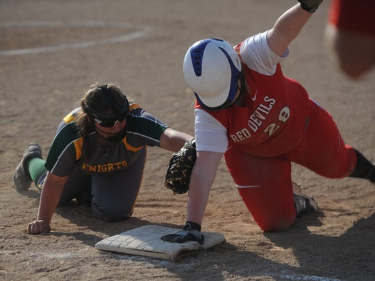 Richmond's Jenna Wilson (29) is safe at first on a pick off throw at Northeastern Monday, April 25, 2016.