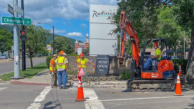 Crews work to enhance pedestrian safety at the intersection of Denison Parkway and Chemung Street.