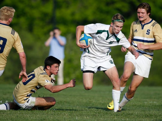 Mark Dombroski gets some running room in Archmere's 20-5 win at Alapocas Run State Park.