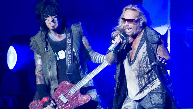 Nikki Sixx (left) and Vince Neil perform with Motley Crue at Klipsch Music Center in 2012 as part of a co-bill with Kiss.