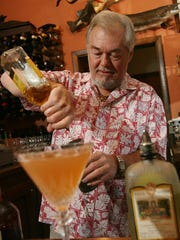 Carl Gerych, bartender at The Lark in West Bloomfield, mixes drinks to complement the restaurant's food on Saturday, August 18, 2007.