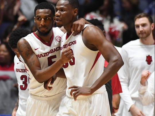 Arkansas Razorbacks forward Arlando Cook (5) celebrates with forward Moses Kingsley (33) after a win against the Mississippi Rebels in the SEC Tournament