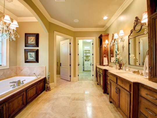 The master bath features warm designer touches.
