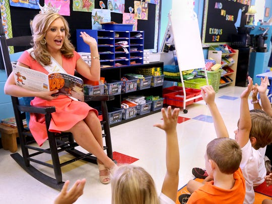 Miss Tennessee 2016, Grace Burgess, reads and interacts with Milddle Tennessee Christian School kindergarten and transitional kindergarten students, during an appearance at the school, on Thursday, Oct. 13, 2016.
