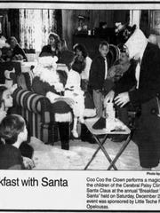 Coo-Coo the Clown entertains Santa and others at the
